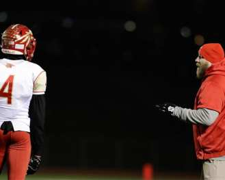 Penn Hills head coach Jon Ledonne talks with Dante Cephas November 23, 2018 — BEN BAMFORD