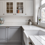 Grey country kitchen with stone worktop
