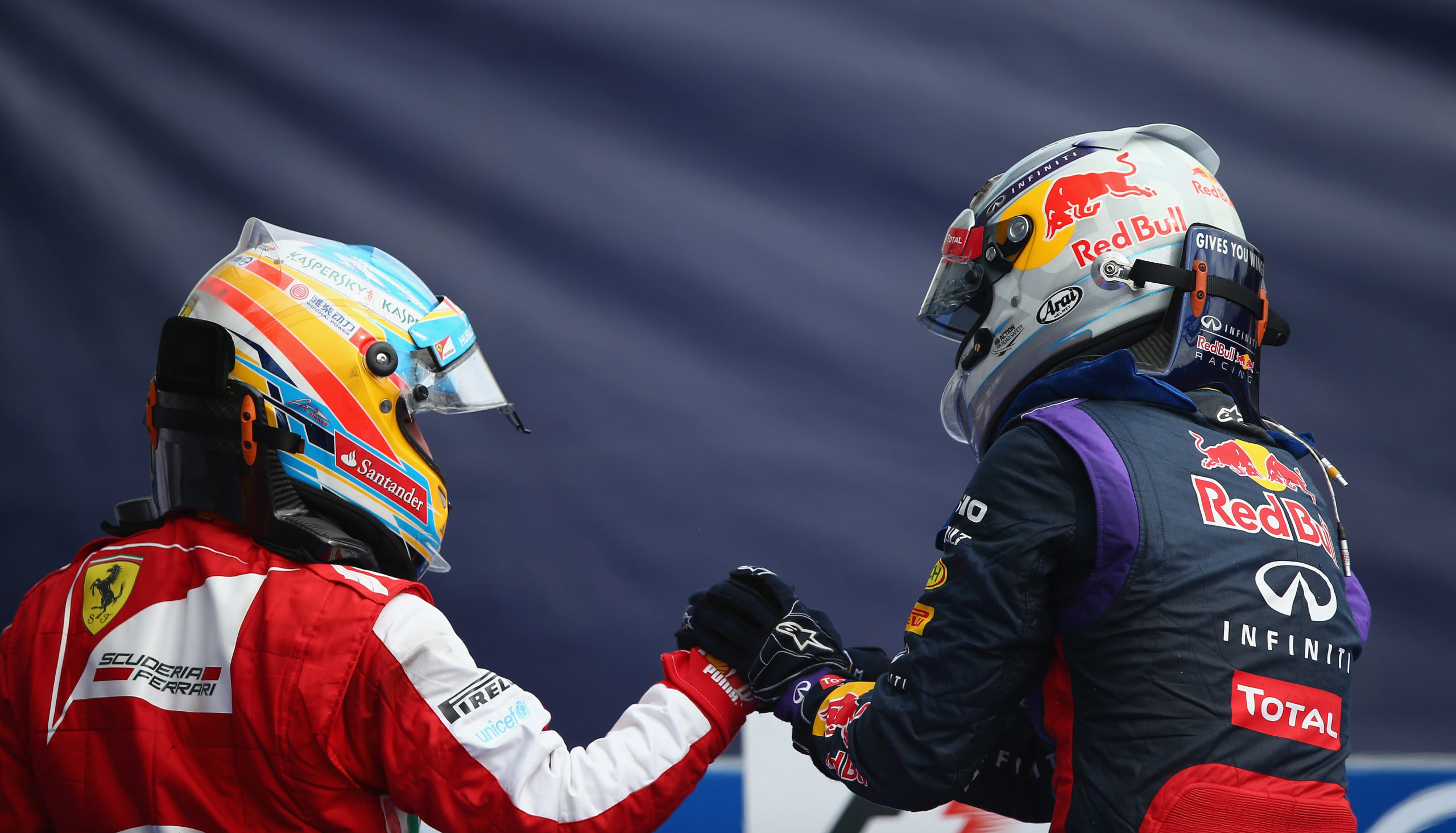 Race winner Sebastian Vettel (R) of Germany and Infiniti Red Bull Racing is congratulated by second placed Fernando Alonso (L) of Spain and Ferrari following the Italian Formula One Grand Prix at Autodromo di Monza in Monza, Italy on September 8th, 2013 // Getty Images / Red Bull Content Pool  // 1378659844563-1957654718 // Usage for editorial use only //