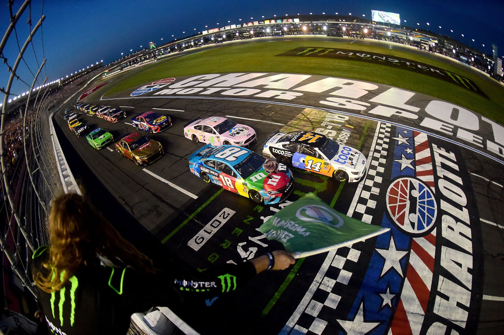 CHARLOTTE, NORTH CAROLINA - MAY 18: Clint Bowyer, driver of the #14 Toco Warranty Ford, leads Kyle Busch, driver of the #18 M&M's Hazelnut Toyota, to start the Monster Energy NASCAR Cup Series All-Star Race at Charlotte Motor Speedway on May 18, 2019 in Charlotte, North Carolina. (Photo by Jared C. Tilton/Getty Images)
