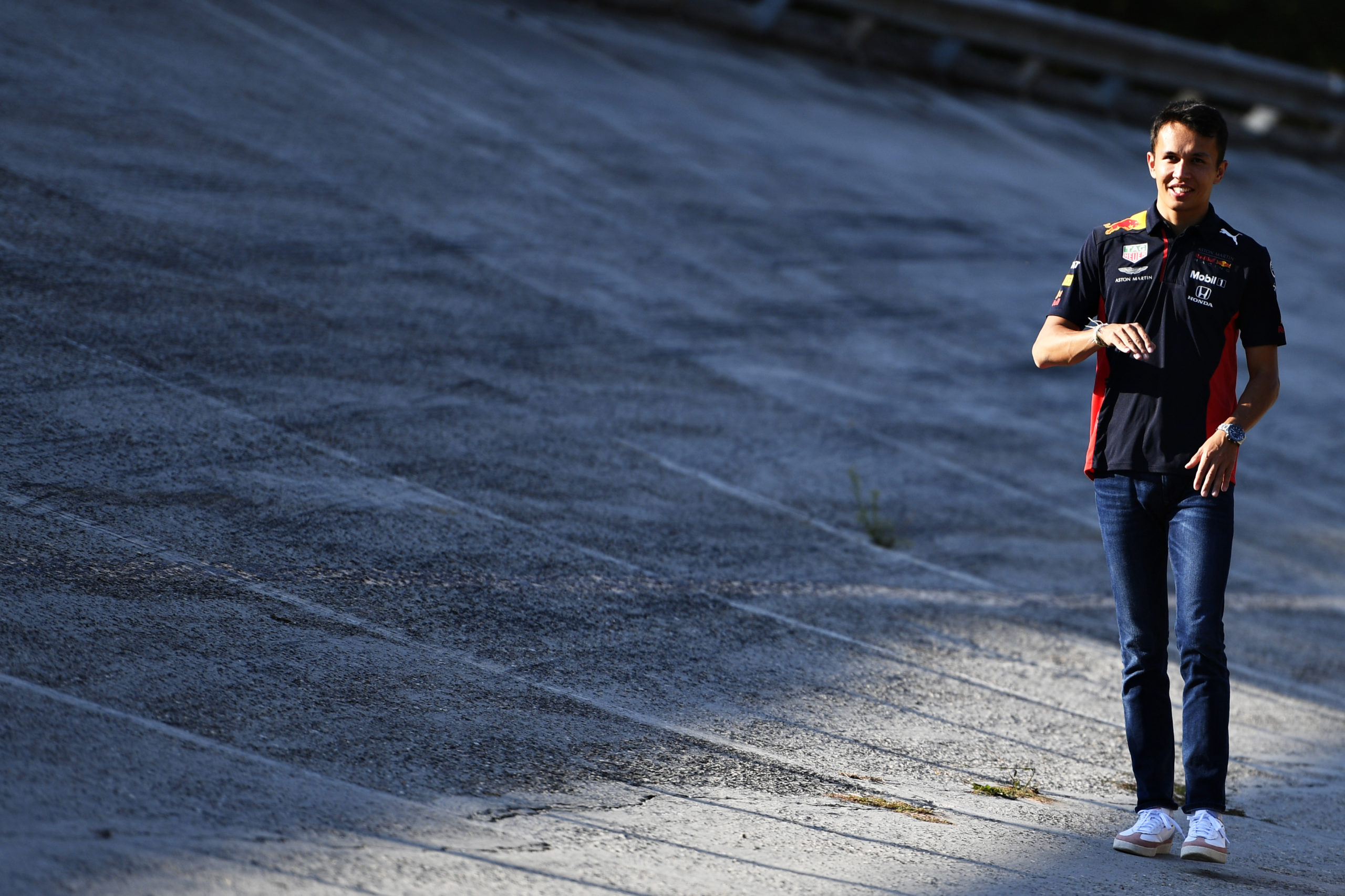 MONZA, ITALY - SEPTEMBER 03: Alexander Albon of Thailand and Red Bull Racing walks on the old circuit banking during previews ahead of the F1 Grand Prix of Italy at Autodromo di Monza on September 03, 2020 in Monza, Italy. (Photo by Rudy Carezzevoli/Getty Images) // Getty Images / Red Bull Content Pool  // SI202009040024 // Usage for editorial use only //