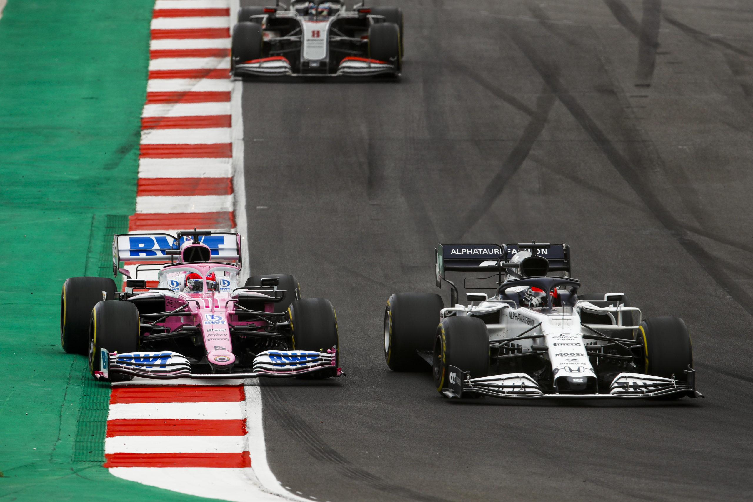 Daniil Kvyat, AlphaTauri AT01, leads Sergio Perez, Racing Point RP20, and Romain Grosjean, Haas VF-20