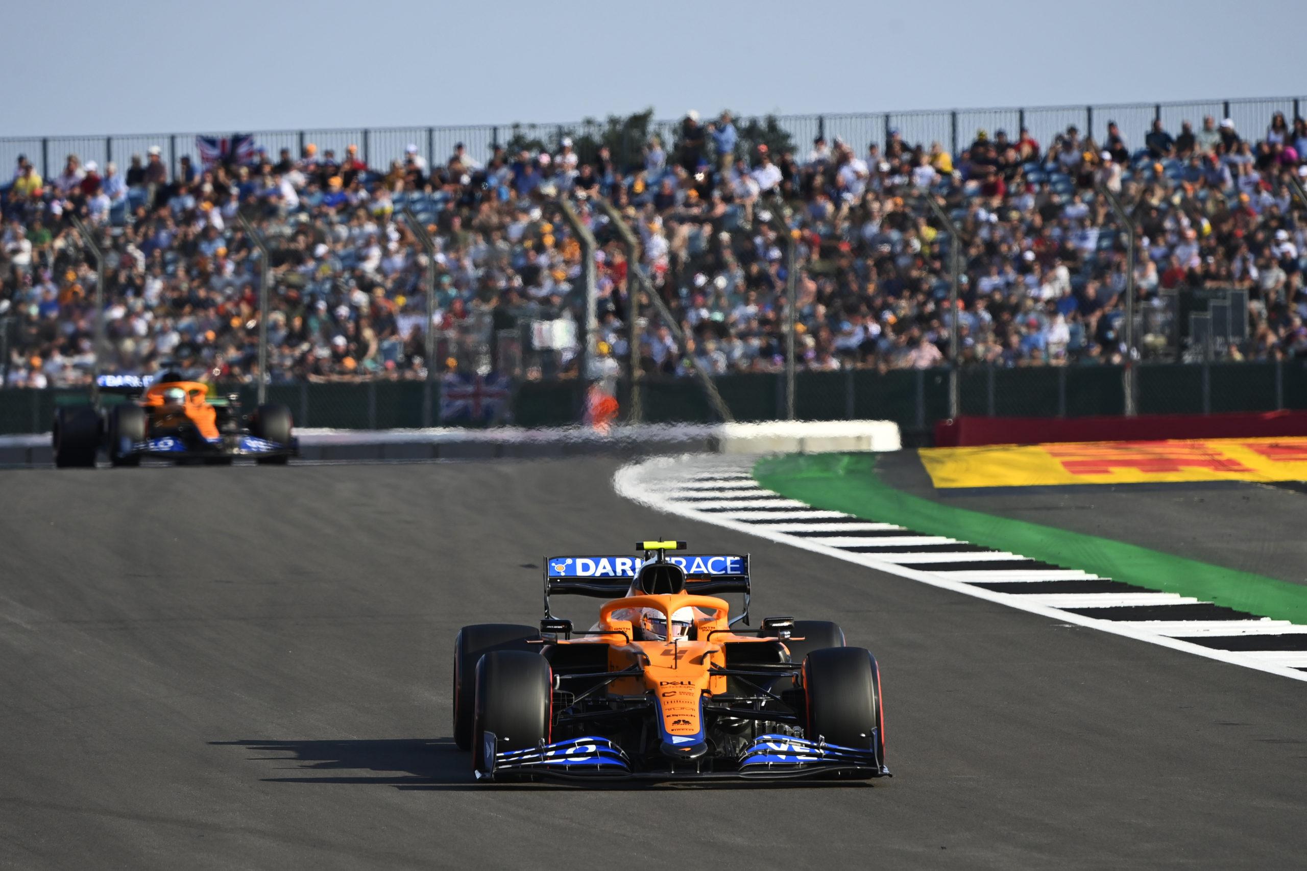 Lando Norris, McLaren MCL35M, leads Daniel Ricciardo, McLaren MCL35M