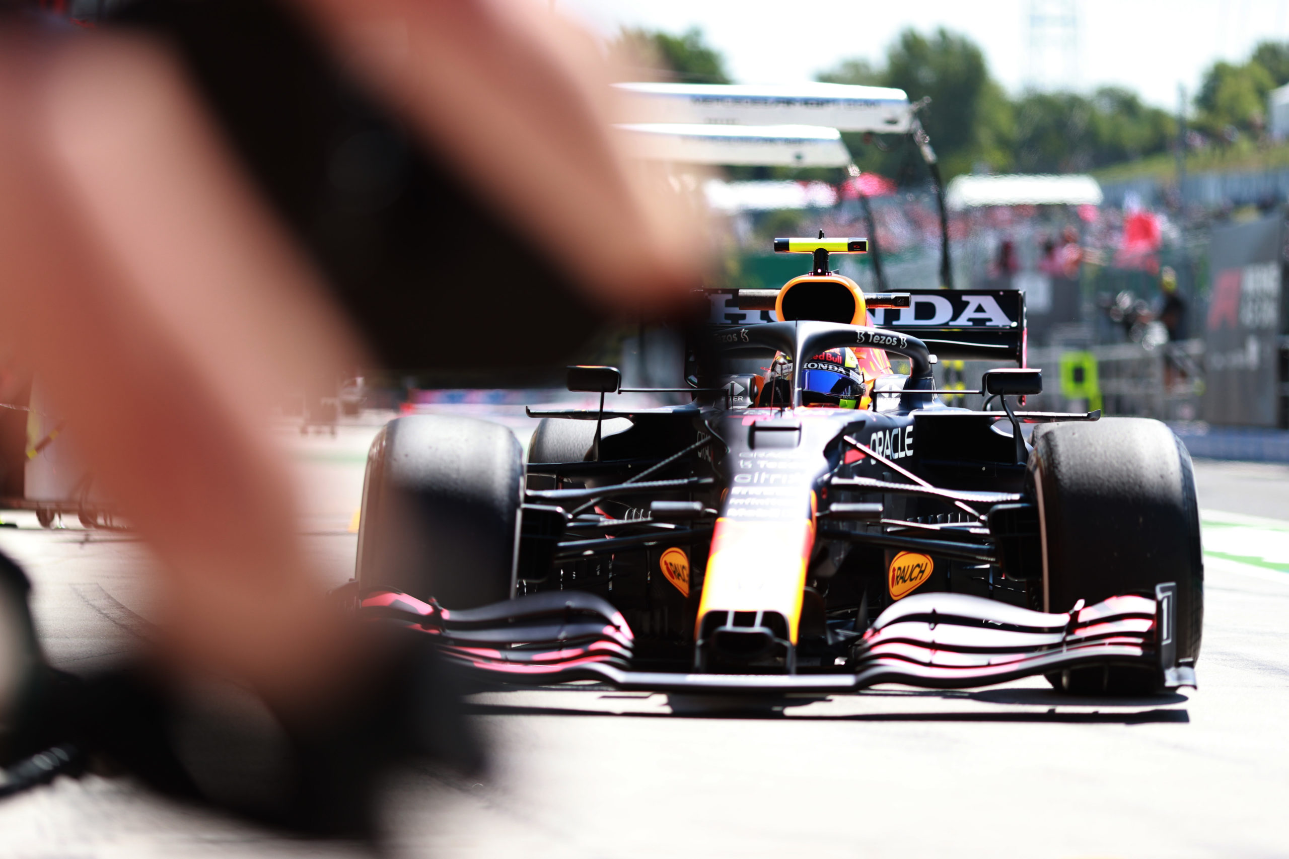 BUDAPEST, HUNGARY - JULY 30: Sergio Perez of Mexico driving the (11) Red Bull Racing RB16B Honda makes a pitstop during practice ahead of the F1 Grand Prix of Hungary at Hungaroring on July 30, 2021 in Budapest, Hungary. (Photo by Mark Thompson/Getty Images) // Getty Images / Red Bull Content Pool  // SI202107300163 // Usage for editorial use only //