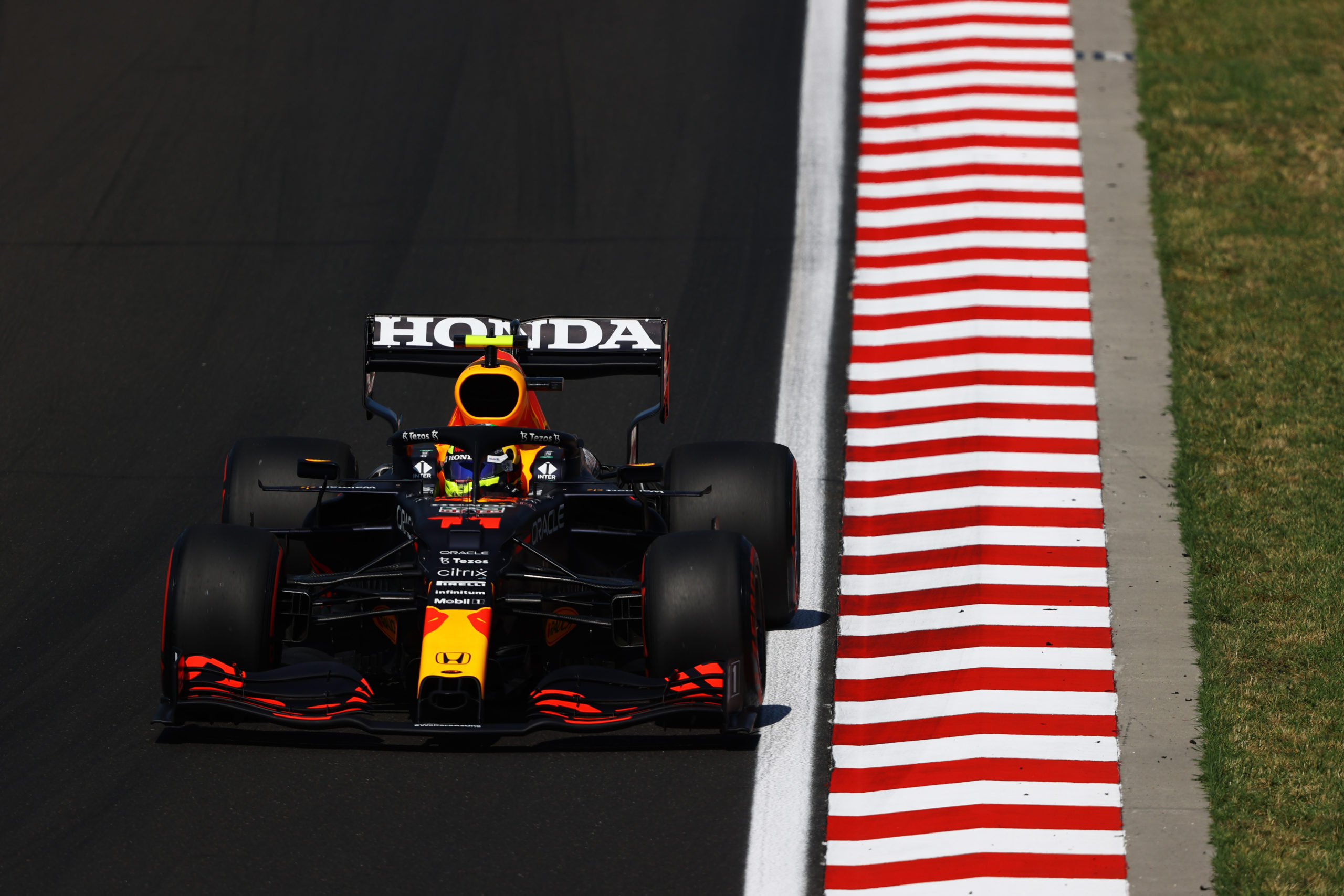 BUDAPEST, HUNGARY - JULY 31: Sergio Perez of Mexico driving the (11) Red Bull Racing RB16B Honda during qualifying ahead of the F1 Grand Prix of Hungary at Hungaroring on July 31, 2021 in Budapest, Hungary. (Photo by Bryn Lennon/Getty Images) // Getty Images / Red Bull Content Pool  // SI202107310256 // Usage for editorial use only //