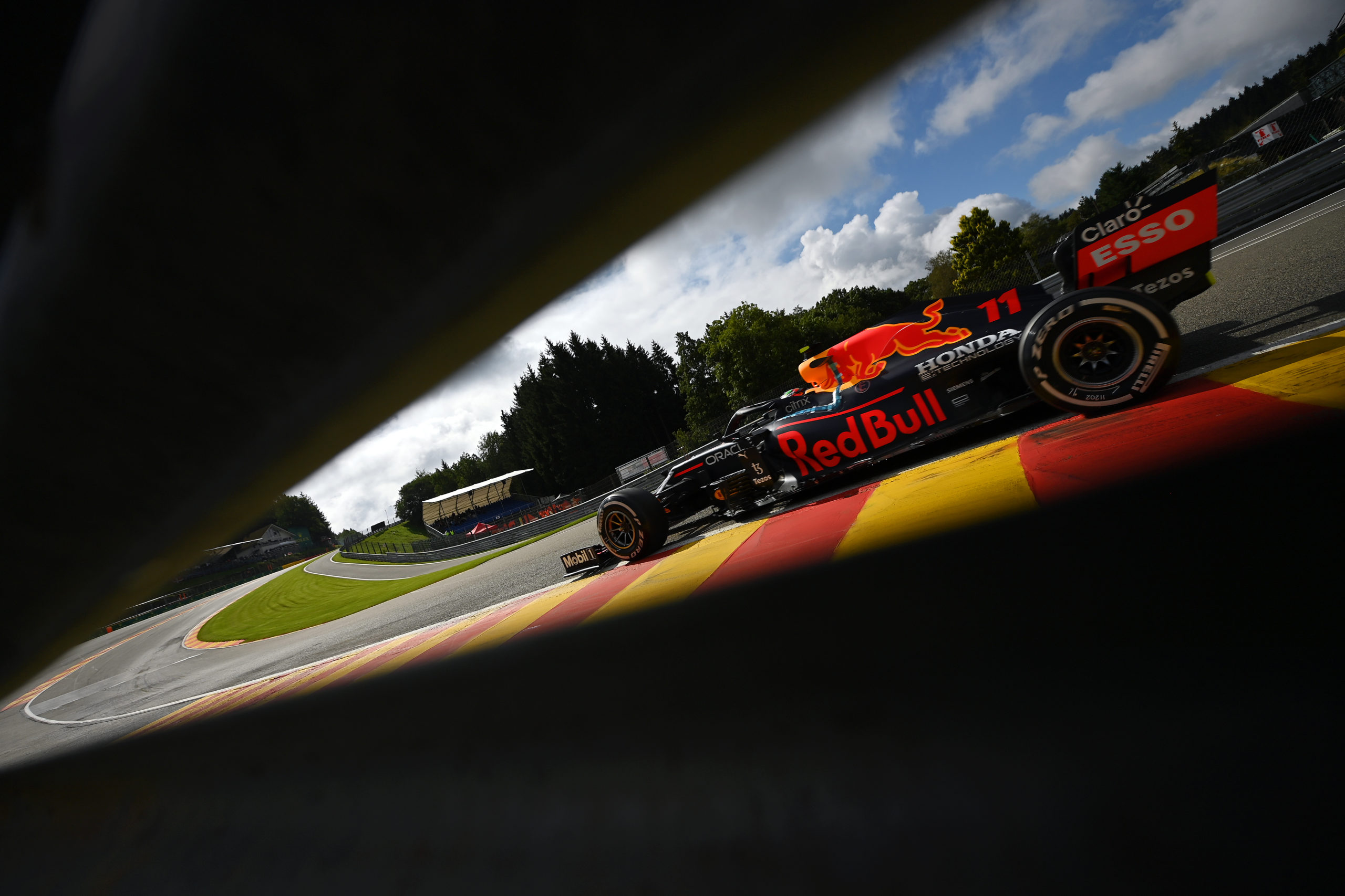 SPA, BELGIUM - AUGUST 27: Sergio Perez of Mexico driving the (11) Red Bull Racing RB16B Honda during practice ahead of the F1 Grand Prix of Belgium at Circuit de Spa-Francorchamps on August 27, 2021 in Spa, Belgium. (Photo by Dan Mullan/Getty Images) // Getty Images / Red Bull Content Pool  // SI202108270096 // Usage for editorial use only //