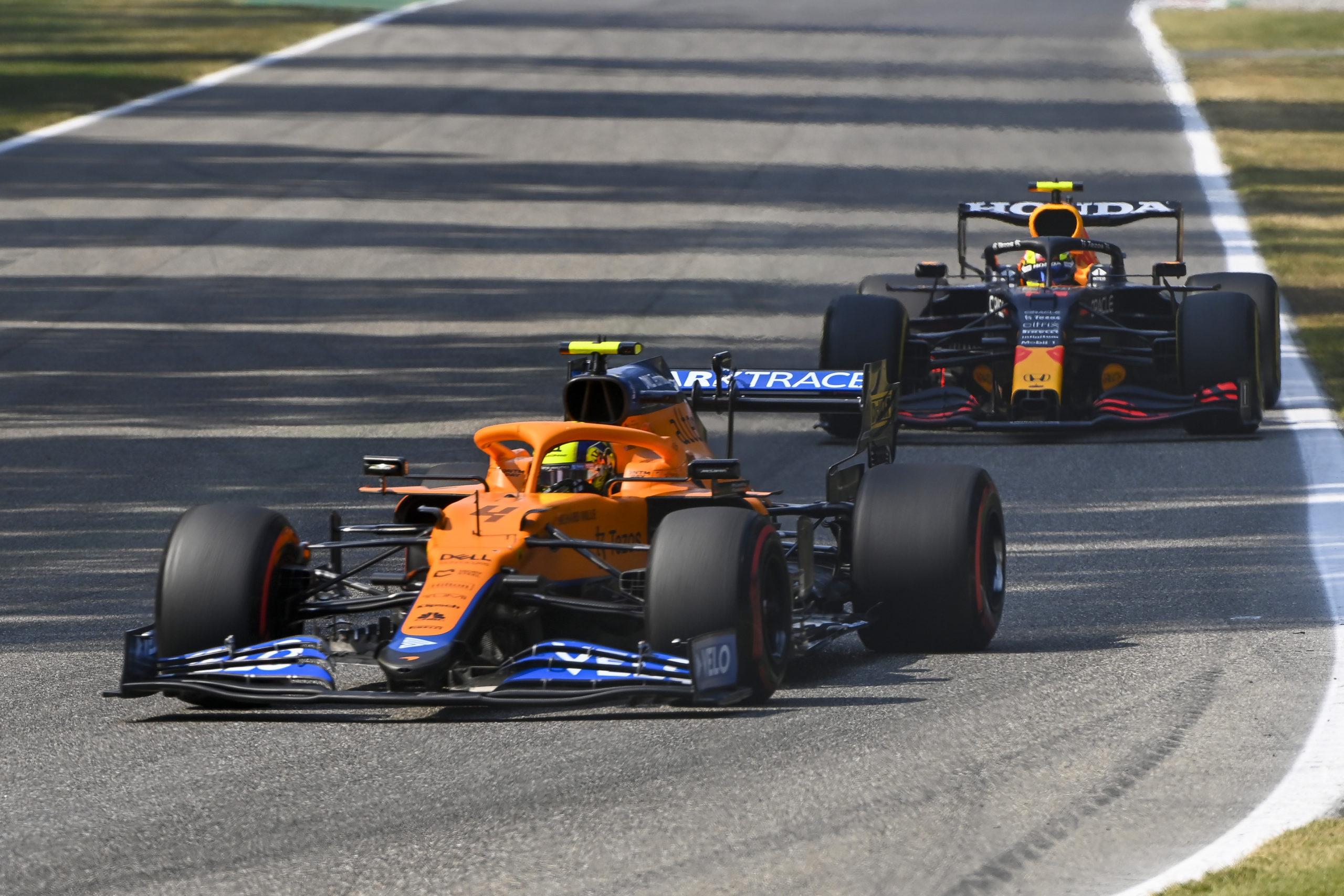 Lando Norris, McLaren MCL35M, leads Sergio Perez, Red Bull Racing RB16B entering a corner