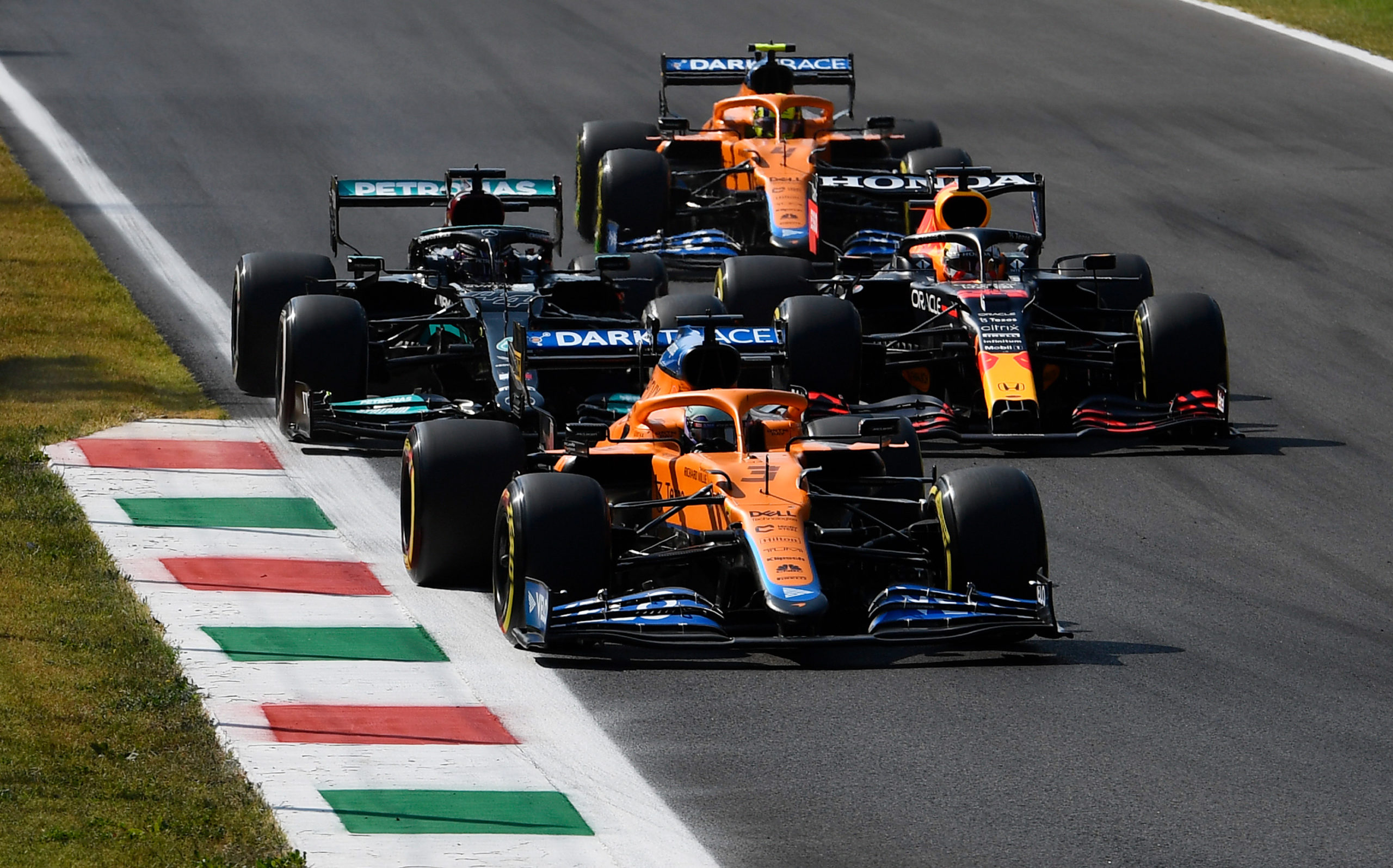 MONZA, ITALY - SEPTEMBER 12: Daniel Ricciardo of Australia driving the (3) McLaren F1 Team MCL35M Mercedes leads Lewis Hamilton of Great Britain driving the (44) Mercedes AMG Petronas F1 Team Mercedes W12 and Max Verstappen of the Netherlands driving the (33) Red Bull Racing RB16B Honda on track during the F1 Grand Prix of Italy at Autodromo di Monza on September 12, 2021 in Monza, Italy. (Photo by Rudy Carezzevoli/Getty Images) // Getty Images / Red Bull Content Pool  // SI202109120251 // Usage for editorial use only //