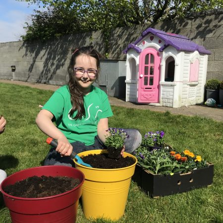 Doireann 2nd Mr. Neary I am putting some plants in our pots to brighten up the garden!