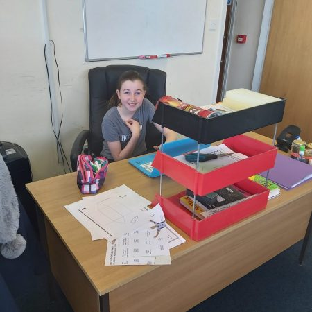 """Lucy 5th Ms. Barron """"This is me doing my school work in my mum and Dads business! I have my own office"""""""