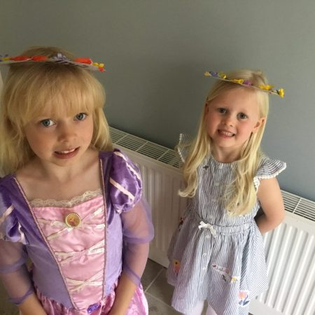 """Elena Sr Inf Ms Durkan """"Elena and her little sister wearing their May crowns"""""""
