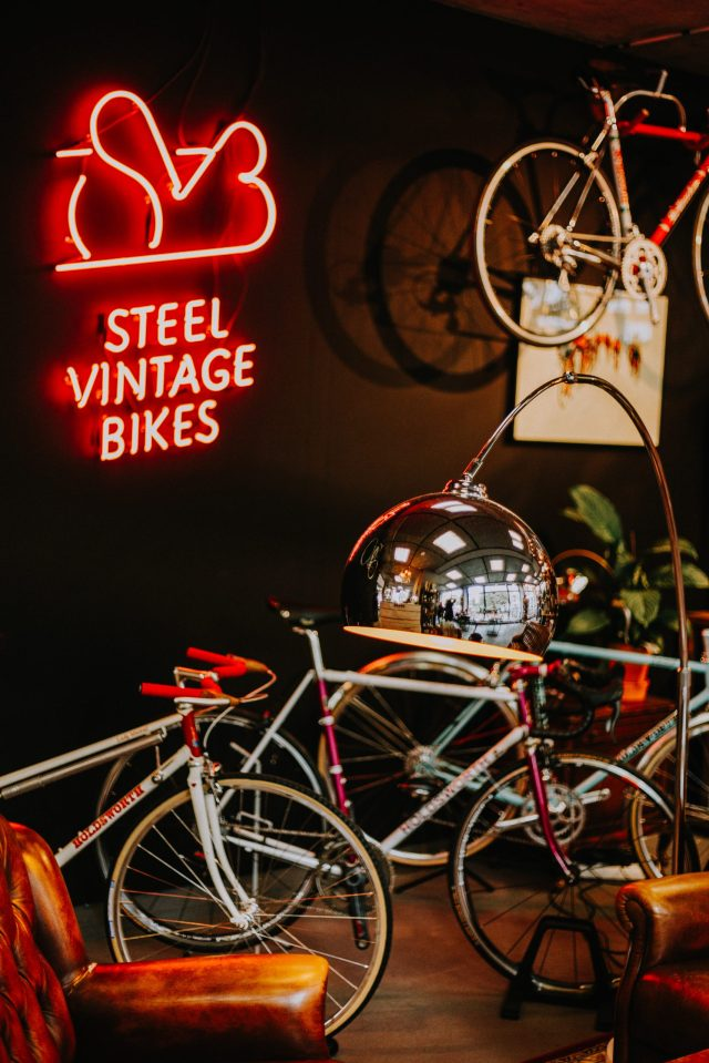 Neon Sign Board and Bicycle