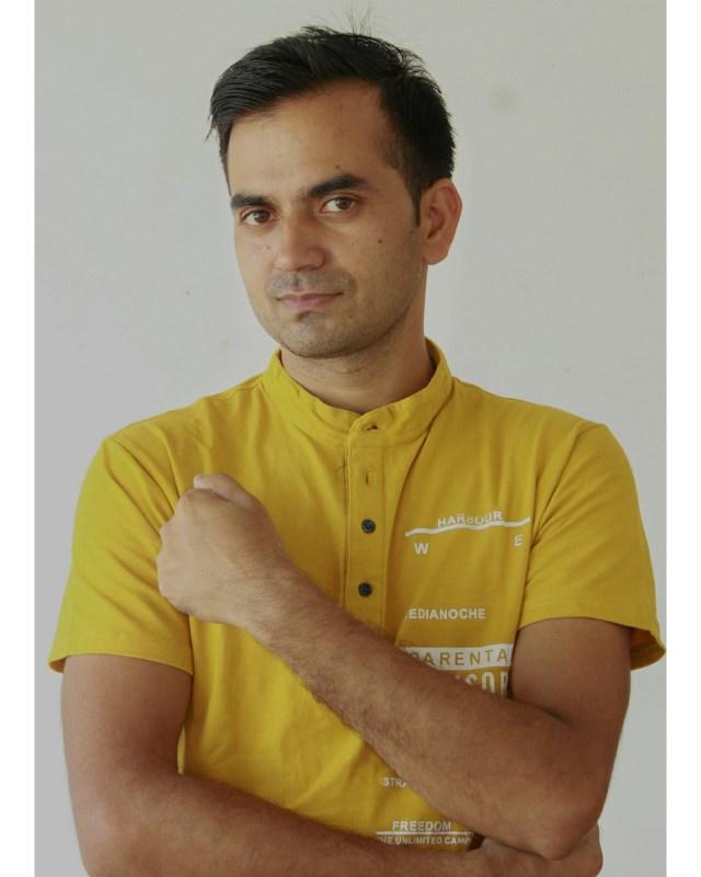 A man holding a fist near his heart