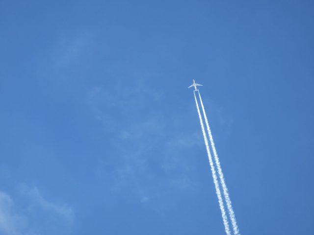 A plane flying at high altitude