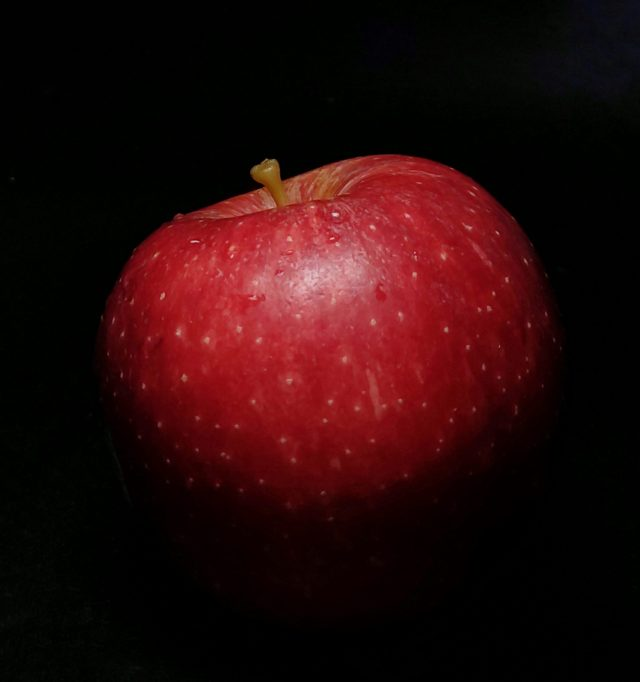 Apple in a black background