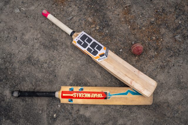 Cricket Bats and Ball Flat lay on the Ground