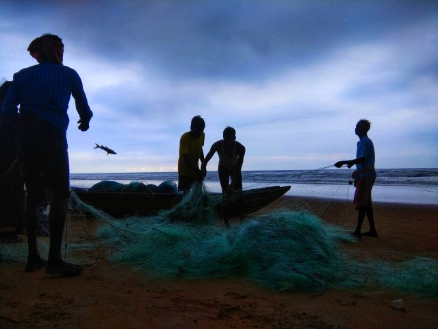 Fishermen arranging net