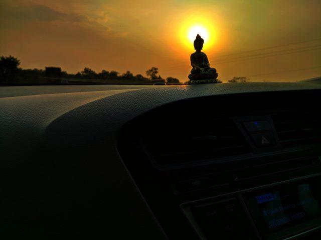 Lord Buddha on Car Dashboard