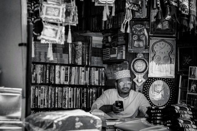 Shopkeeper watching over his merchandise