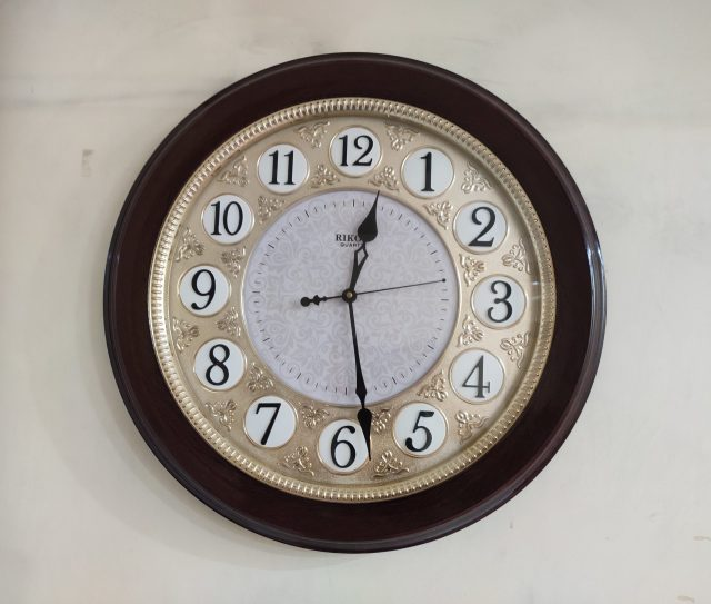 Wooden clock on a wall