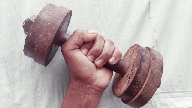 A dumbbell in hand