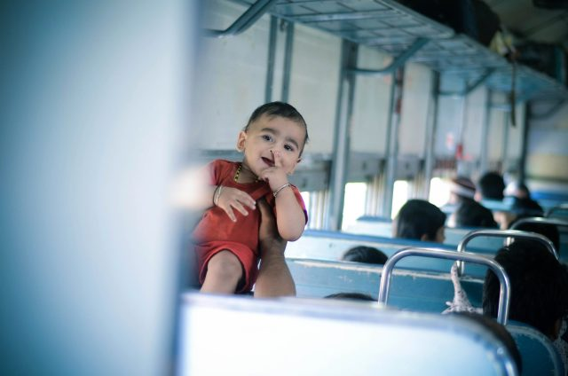 A kid in a passenger train