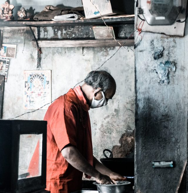 A man cooking in his shop