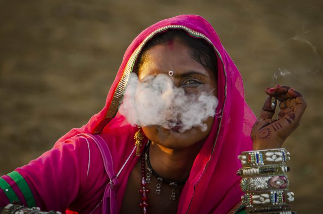 A tribal woman smoking