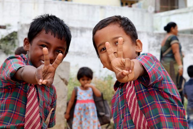Happy kids showing victory sign