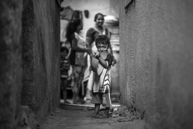 kid in a narrow lane
