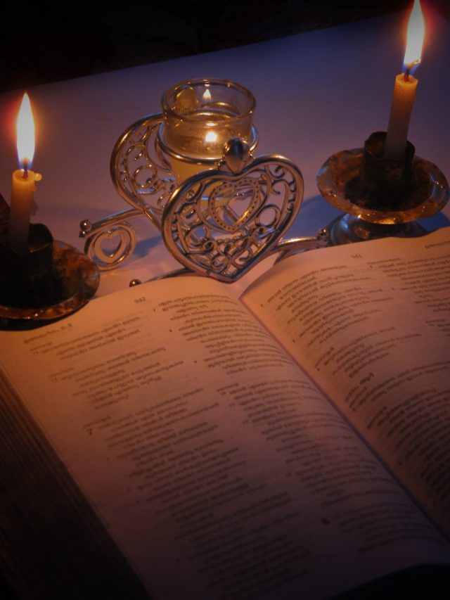 Reading Bible in candle light