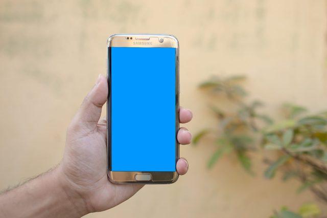 A Samsung smartphone in hand