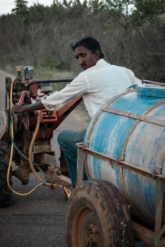 A man carrying water tank