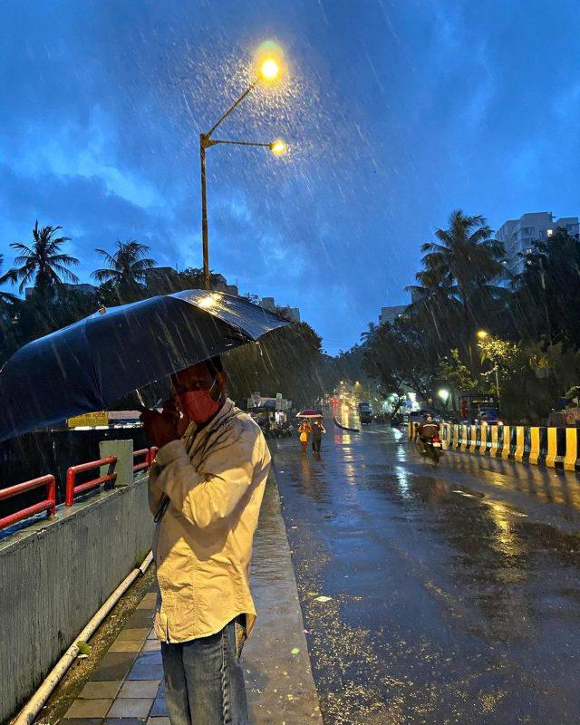 A man with umbrella in rain