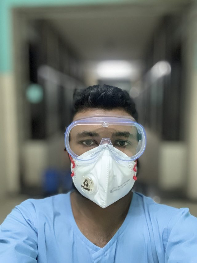 A doctor in scrub suit