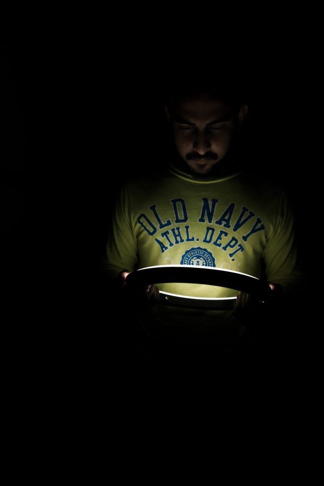 A boy in dim light