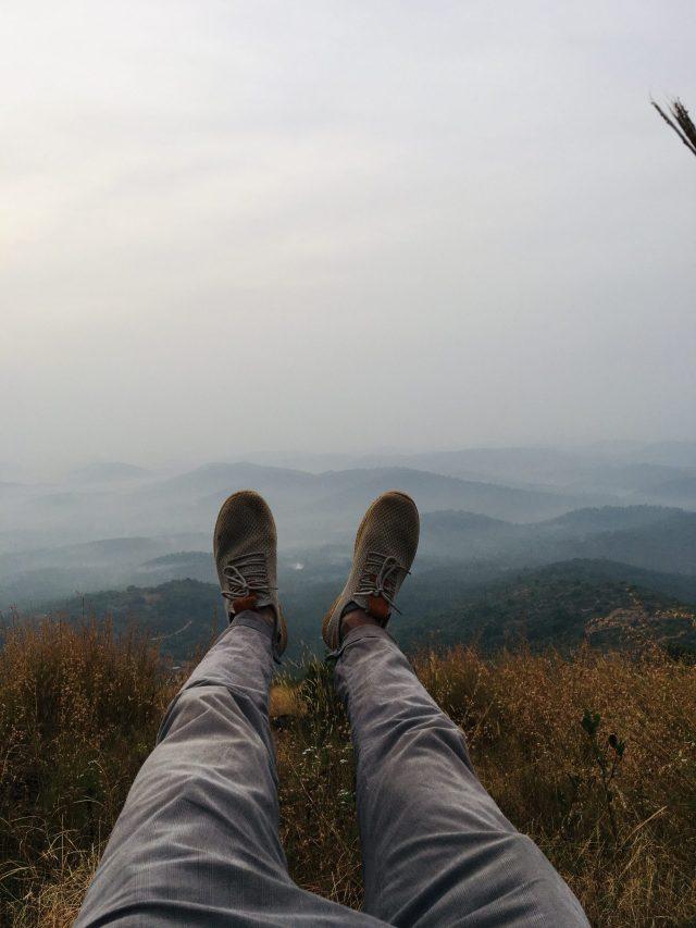 legs against mountains