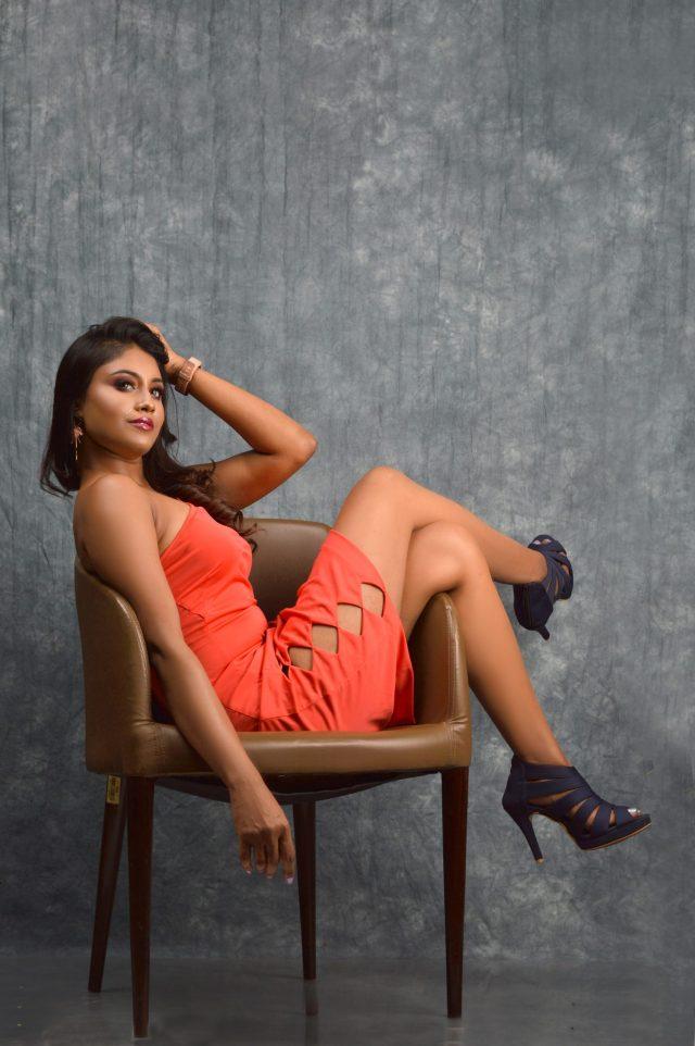 A fashion model on a chair