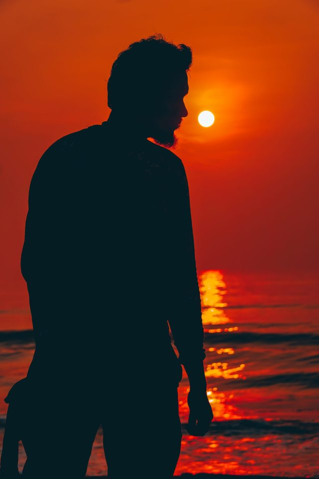 A man enjoying sunrise
