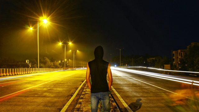 A boy on a road divider