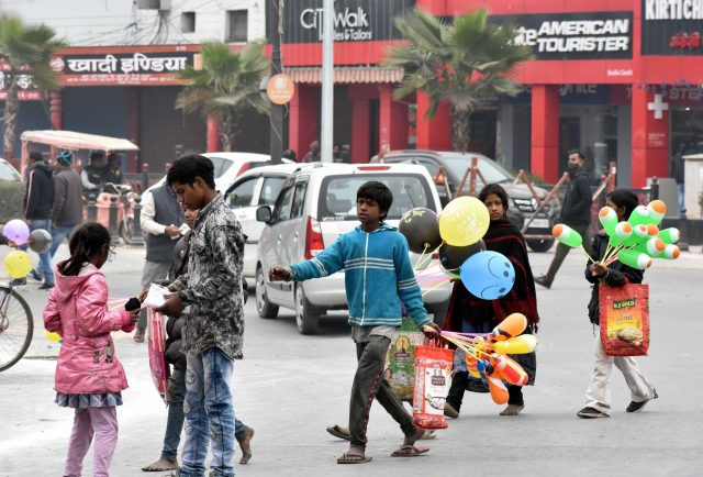 Kids selling balloons on road