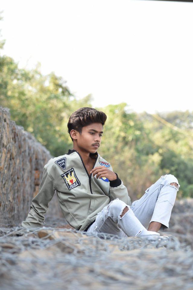 Boy posing while sitting