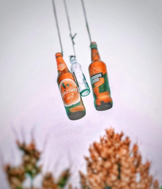 Beer bottles hanging with ropes