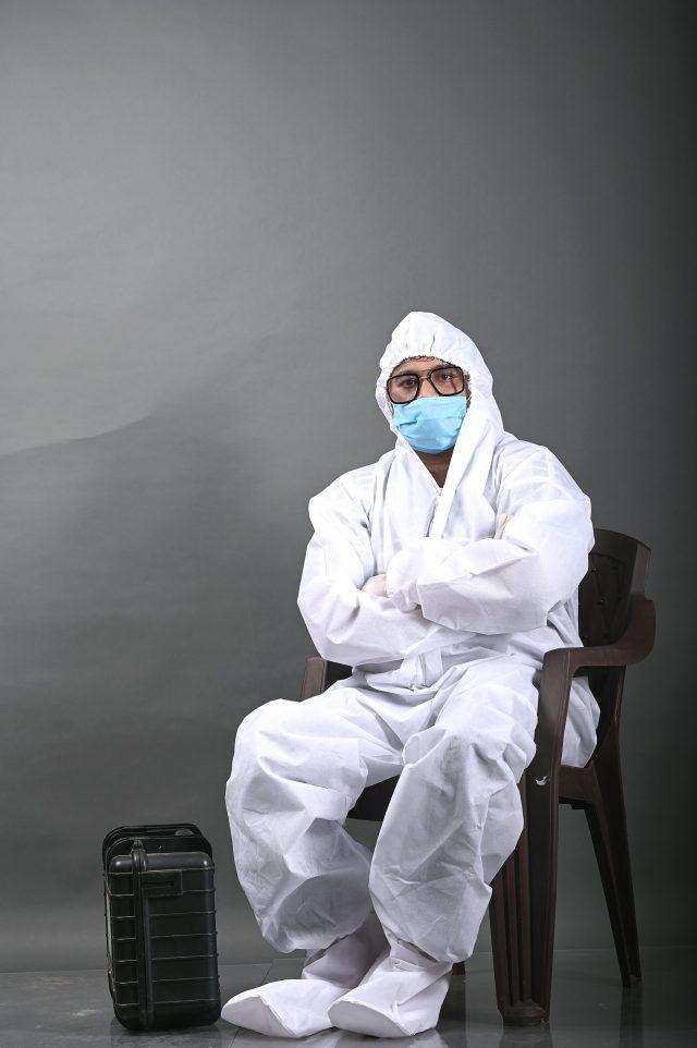 Man in PPE kit