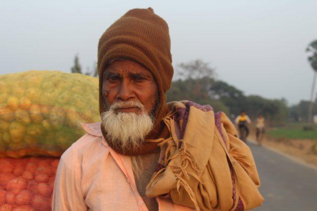 Old vegetable vendor