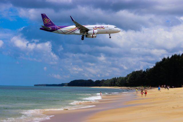 A flight going over a beach in Phuket