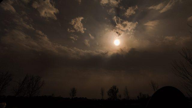 Sun in between dark clouds