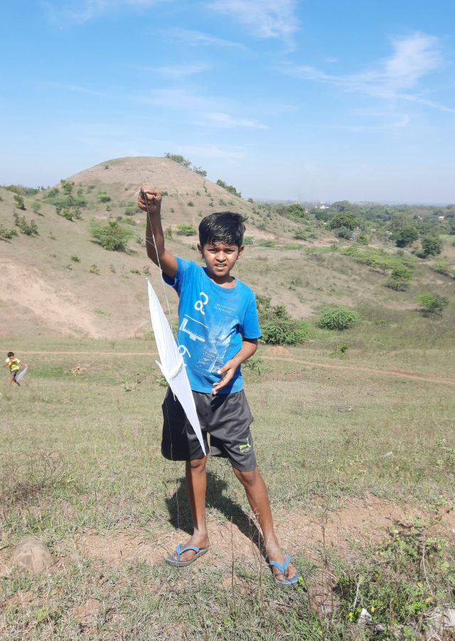 A kid flying a kite