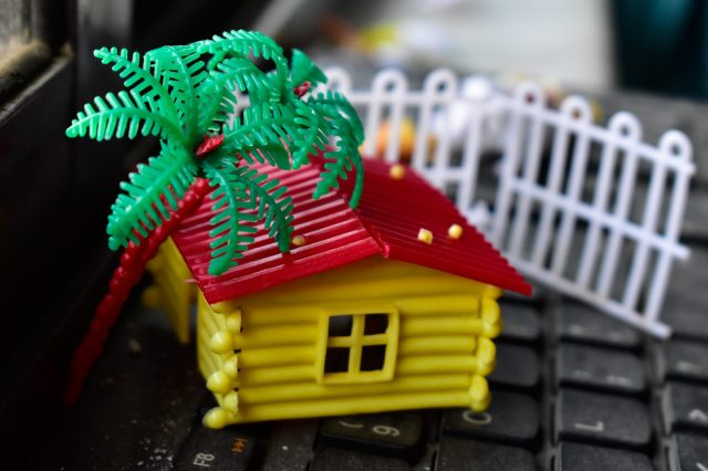 Toy House with Garden on keyboard