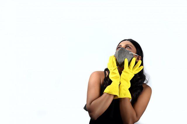 Woman posing in mask